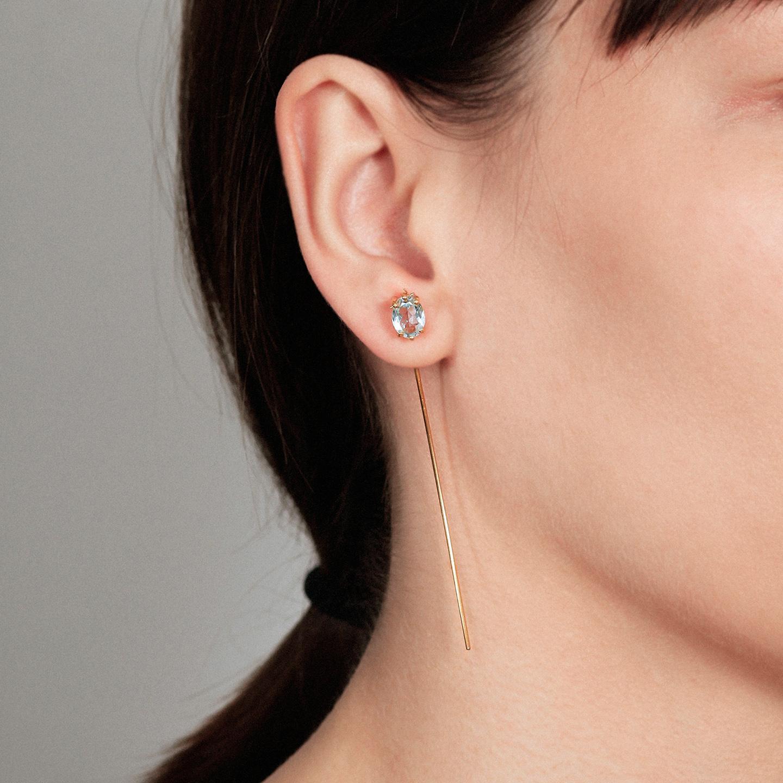 Long blue topaz tusk gold earring