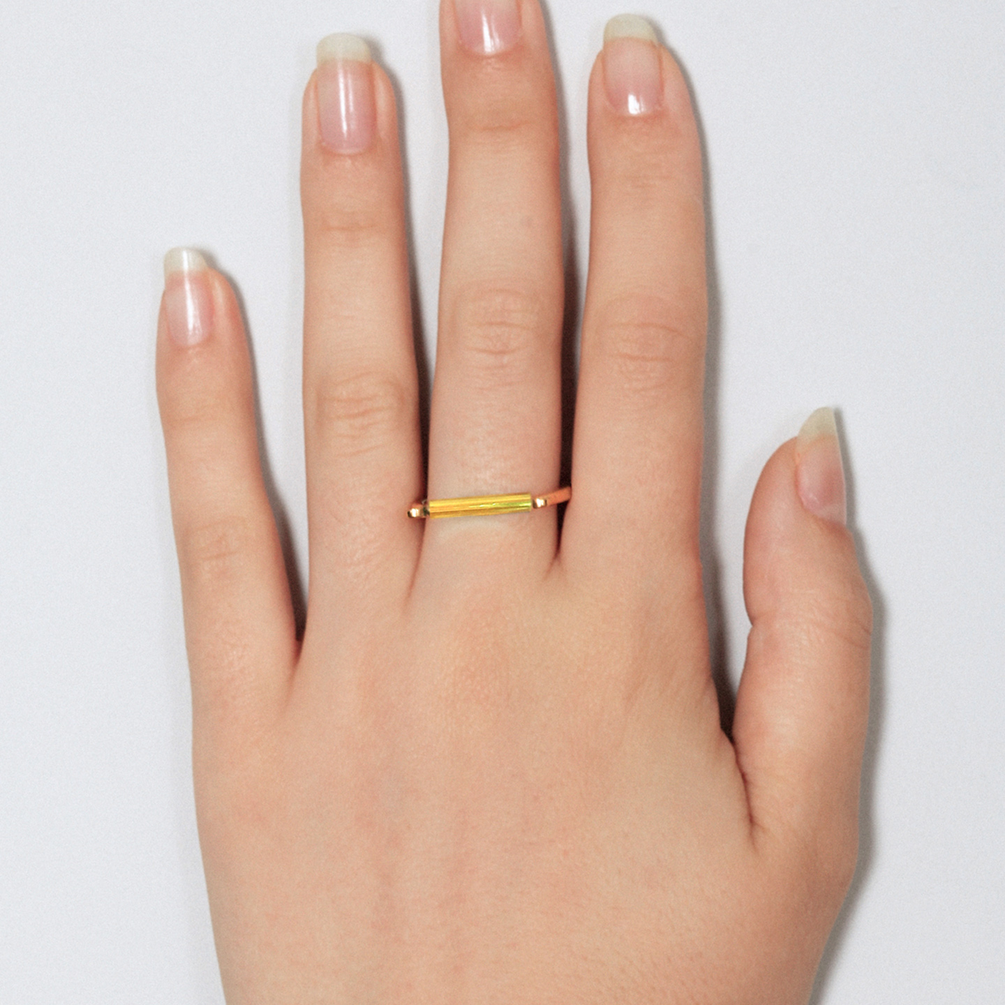 Gold ring with minimalist neon lemon bar