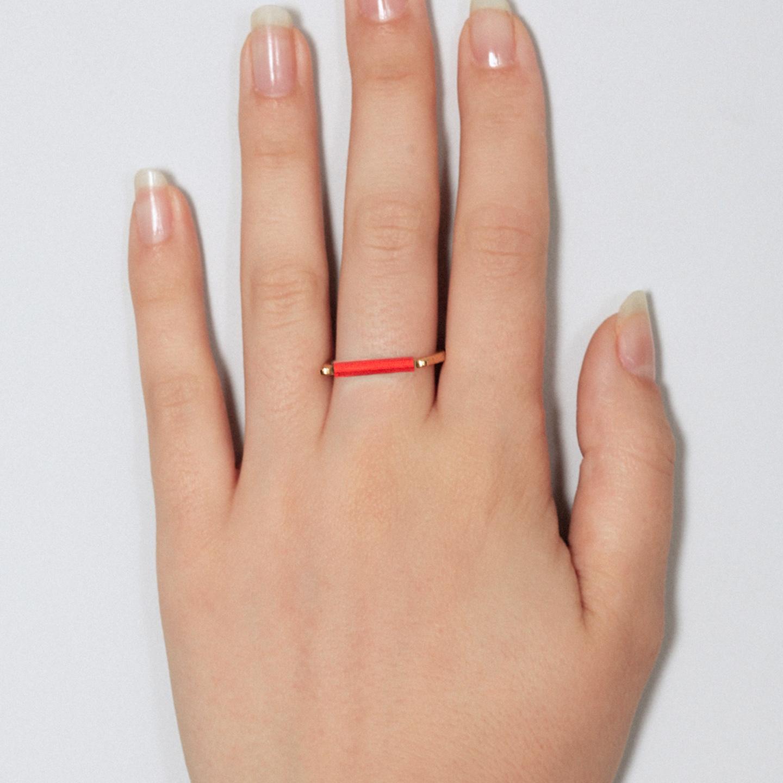 Gold ring with minimalist neon orange bar