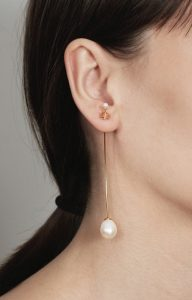 Long gold earring with pearls