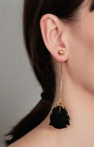 Long gold earring with a preserved natural black rose
