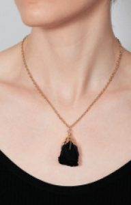 Gold necklace with natural black rose