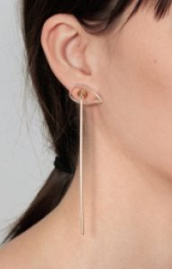 Long minimalist gold earring with false dilation