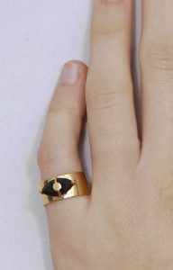 Gold ring with a black spinel